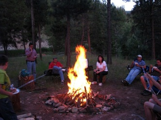 Guests around campfire